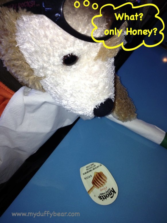Duffy the Disney Bear is wondering why he only has a little jar of honey in front of him