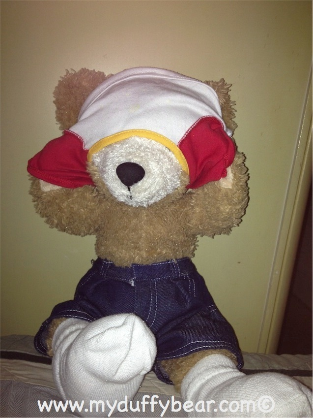Duffy the Disney Bear gets his Tee Shirt stuck over his eyes