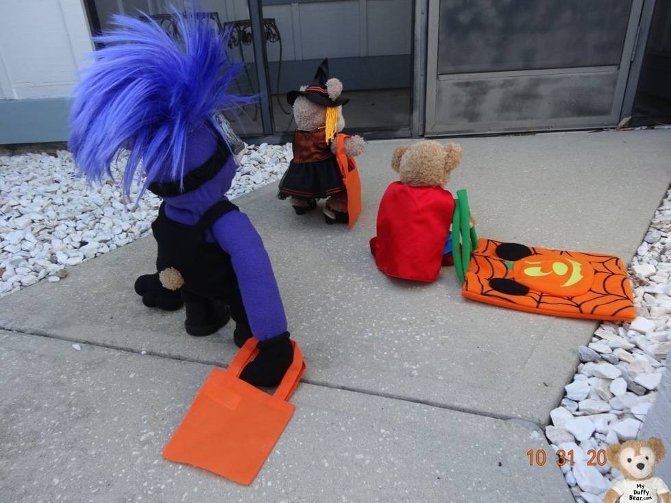 Duffy the Disney Bear trick or treats at another house