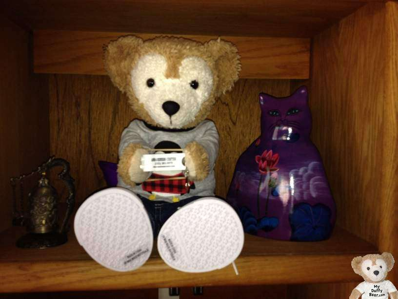 Duffy the Disney Bear poses with his free keychain flashlight on a shelf