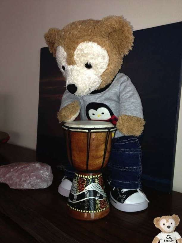 Duffy the Disney Bear finds a drum that's just his size