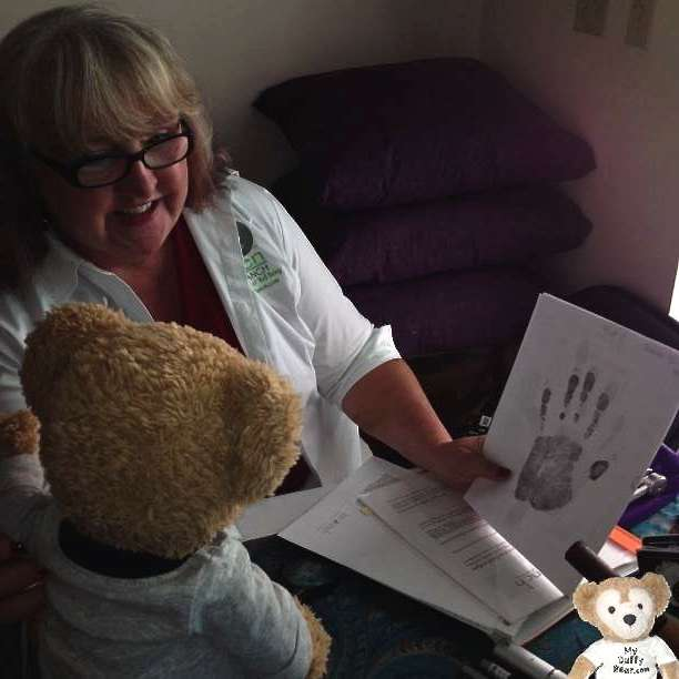 Duffy the Disney Bear learns about paw reading for life purpose