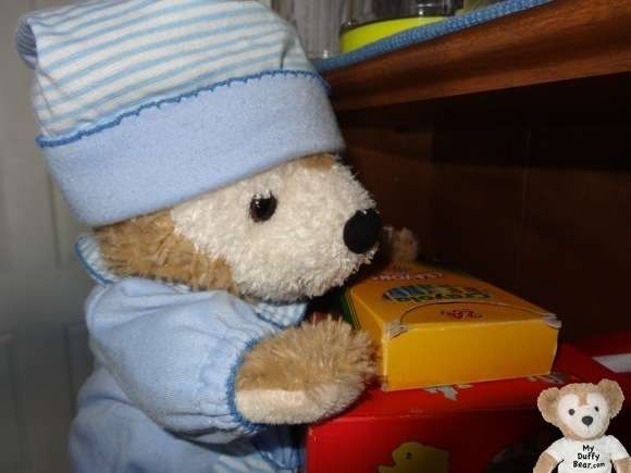 Duffy the Disney Bear get the crayons off the shelf