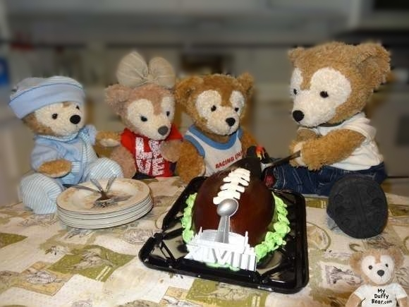 Duffy the Disney Bear cuts a Super Bowl football cake
