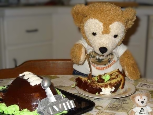 Duffy the Disney Bear eats his Super Bowl Football cake