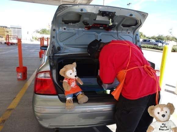 Duffy the Disney Bear help pack car at Home Depot