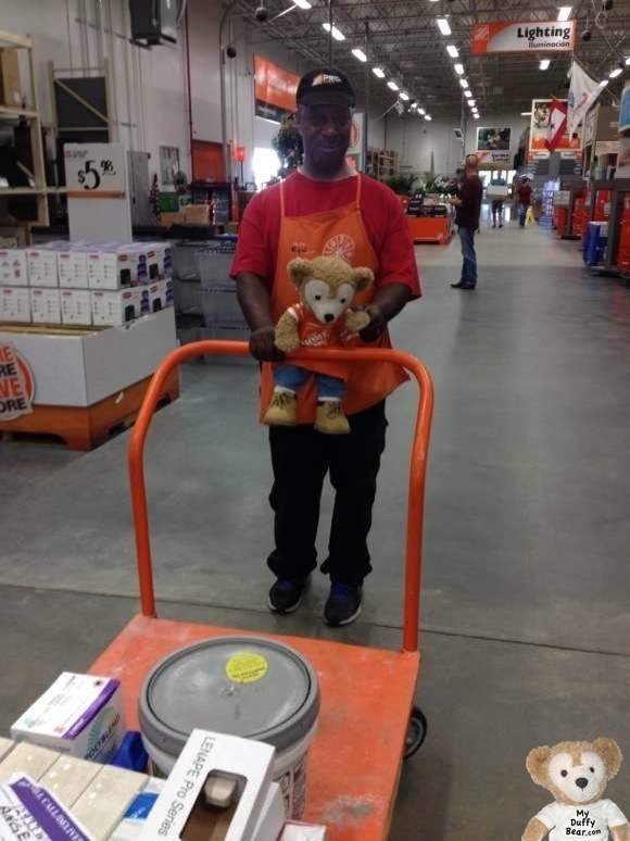 Duffy the Disney Bear Pushes Big Orange Cart at with Home Depot Associate