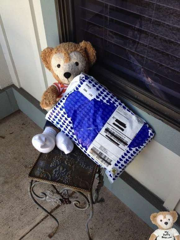 Duffy the Disney Bear gets a package from Build -A-Bear