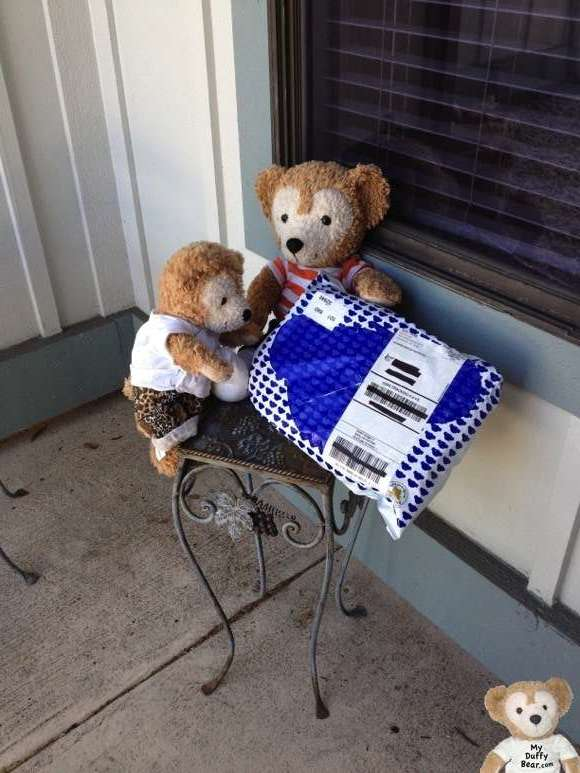 Duffy the Disney Bear gets a package from Build-A-Bear Workshop