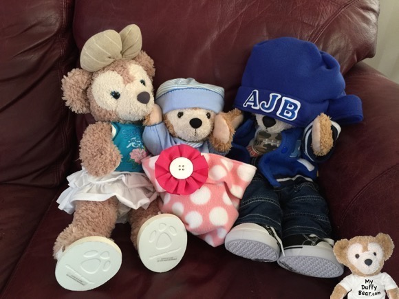 Duffy the Disney Bear puts his paws up to his hospital baby cap so it didn't slip down over his eyes too!