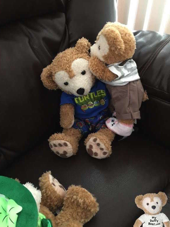 Duffy the Disney Bear whispers back into his older brother's ear.
