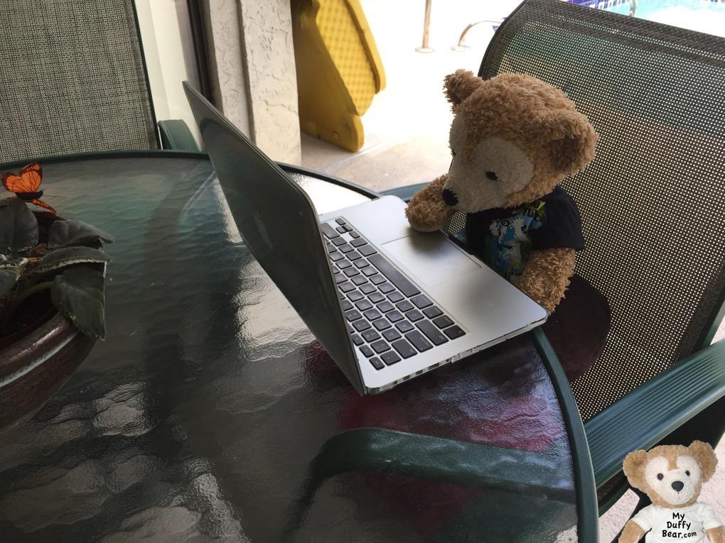 Duffy the Disney Bear checks his email on his MacBook Pro