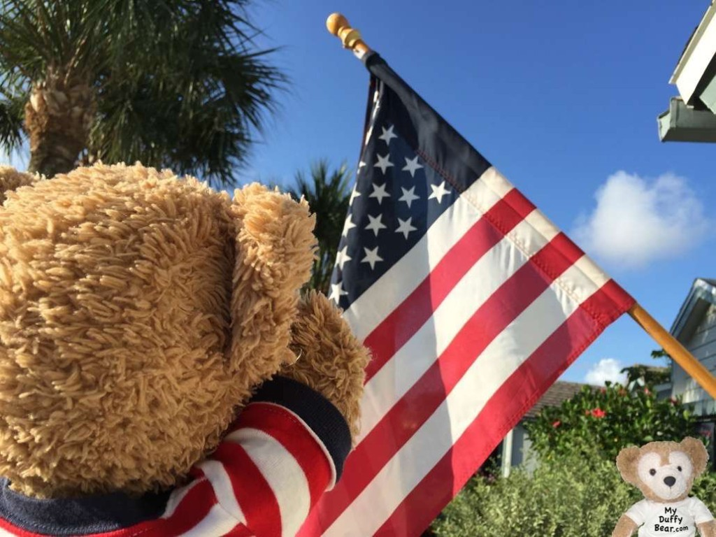 Duffy the Disney Bear salutes the flag on Memorial Day