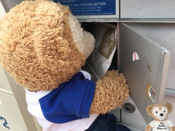 Duffy the Disney Bear goes to the mailbox to look for his Teddy Olympics Medal