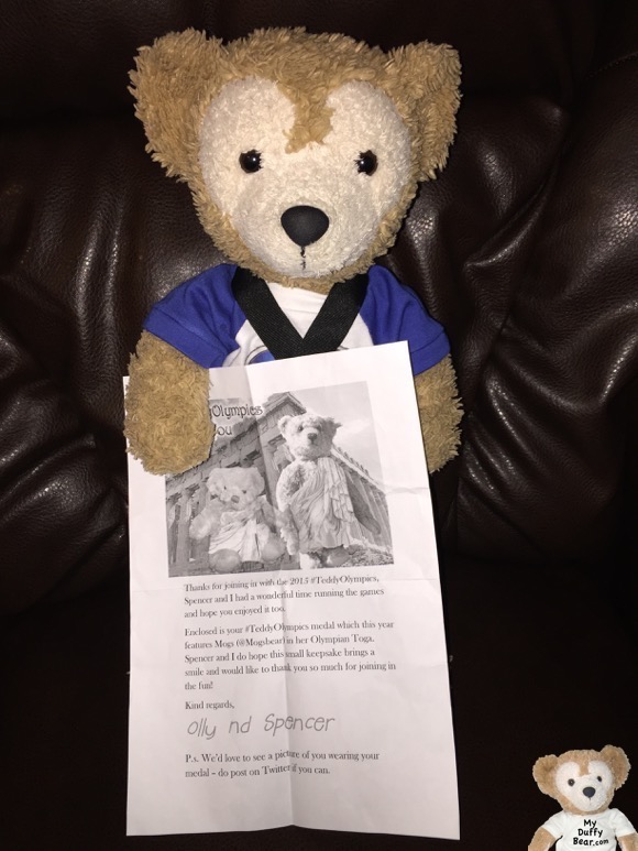 Duffy the Disney Bear shows off his special Teddy Bear Olympics letter