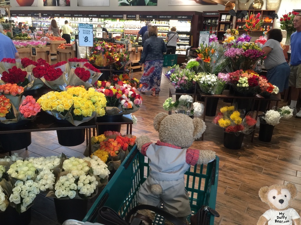 Duffy the Disney Bear checks out the flower department at The Fresh Market Grand Opening.