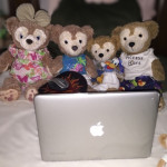 Duffy the Disney Bear & family watching YouTube on his MacBook Pro