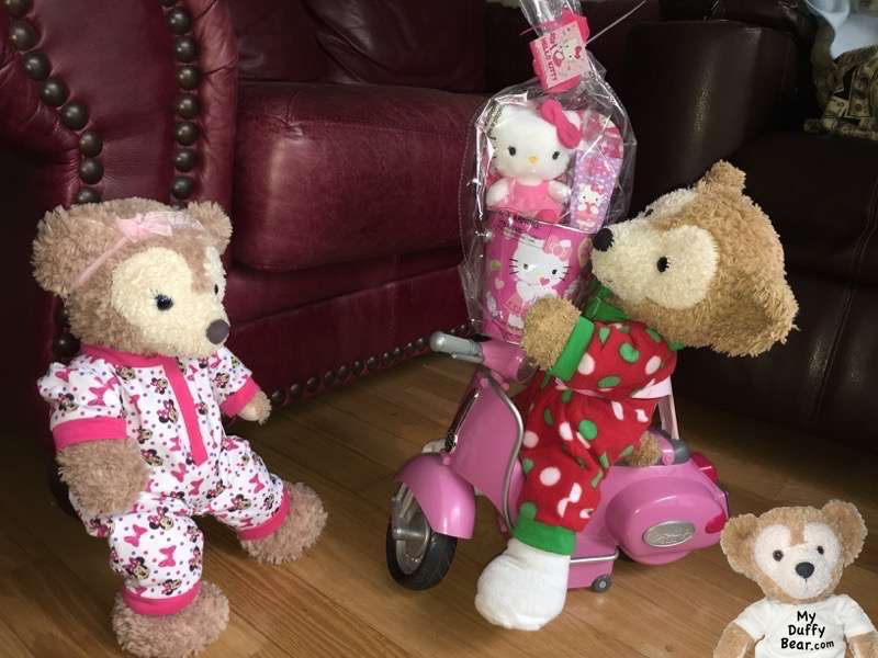 Duffy the Disney Bear rides up on his scooter with a Valentine's Day gift for ShellieMay