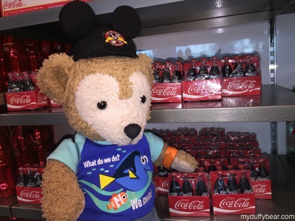 Duffy the Disney Bear likes the small coke bottles, but knows he'll need lots and lots of them to drink with his popcorn