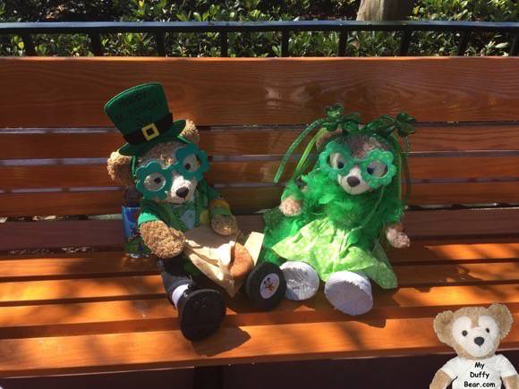 Duffy the Disney Bear, dressed up for Saint Patrick's, eats a Cronut