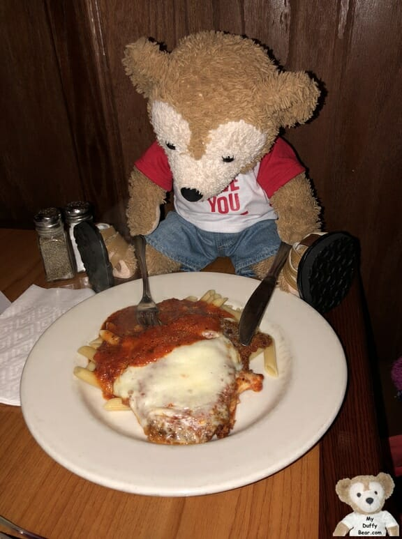 Duffy digs into his Amici's Italian Restaurant Veal Parmesan