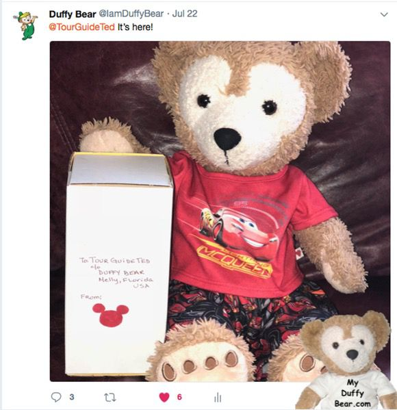 Duffy holds box for TourGuideTed